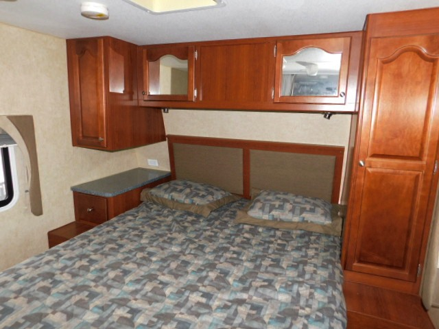 PROWLER 230RK BEDROOM with SIDE TABLES and STORAGE ABOVE