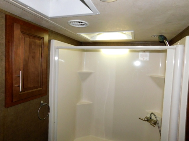SHOWER with SKYLIGHT and LINEN STORAGE