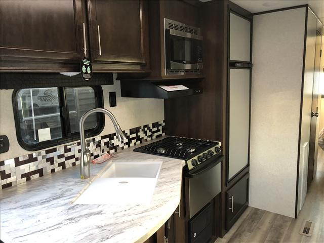upgraded kitchen w microwave, 3 burner stove top/oven and 8 cu ft fridge