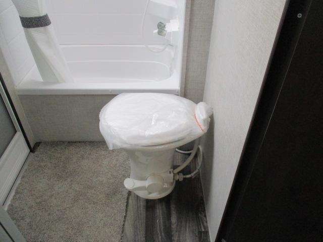 Foot flush porcelain toilet
