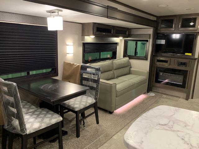 FREE STANDING DINETTE/SOFA/ENTERTAINMENT CENTER